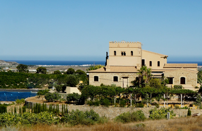A back view of the house framed by the Mediterranean Sea